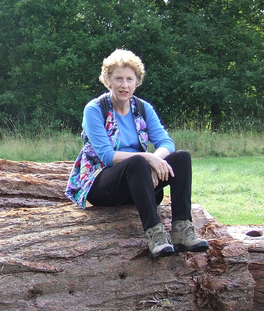 Molly Tabram sitting on a fallen tree circa 2006
